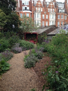 The Chelsea Physic Garden, overlooked by the tall townhouses of Chelsea
